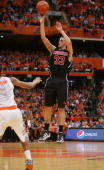 Mike Marra of the Louisville Cardinals shoots the ball during the game against the Syracuse Orange at the Carrier Dome on February 14 2010 in...