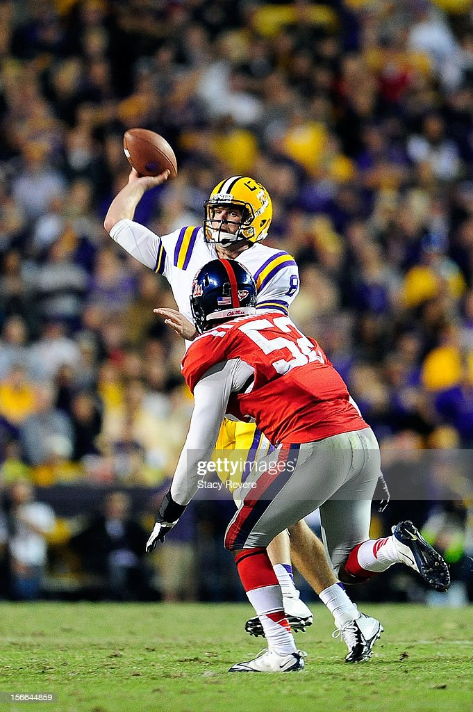 Mike Marry #52 of the Ole Miss Rebels pressures <a gi-track='captionPersonalityLinkClicked' href=/galleries/search?phrase=Zach+Mettenberger&family=editorial&specificpeople=6548476 ng-click='$event.stopPropagation()'>Zach Mettenberger</a> #8 of the LSU Tigers during a game at Tiger Stadium on November 17, 2012 in Baton Rouge, Louisiana.