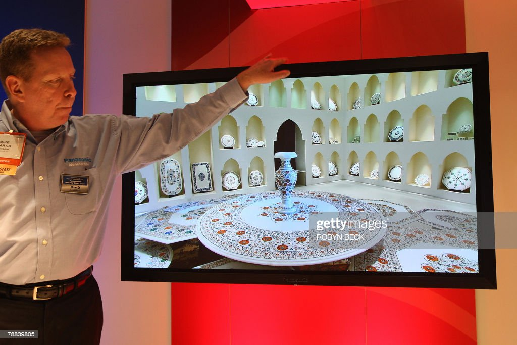 Mike Martin displays Panasonic's oneinch thick plasma HDTV at the 2008 Consumer Electronics Show in Las Vegas 08 January 2008 The 50inch display will...