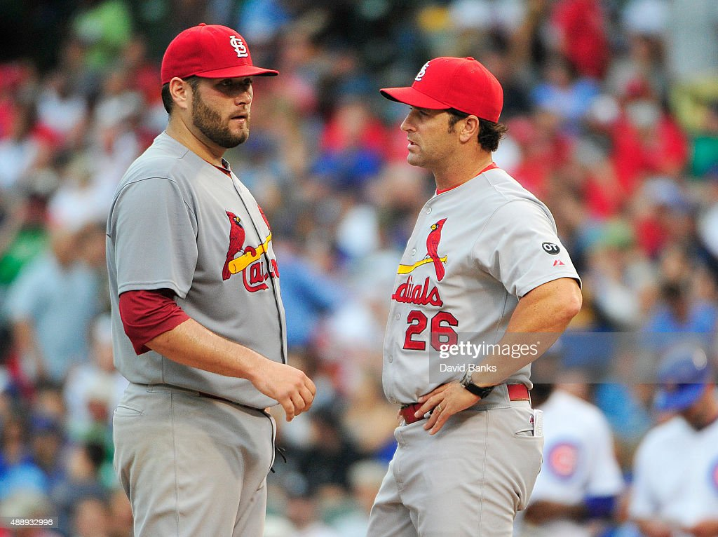 Mike Matheny manager of the St Louis Cardinals takes Lance Lynn out of the game against the Chicago Cubs during the fourth inning on September 18...