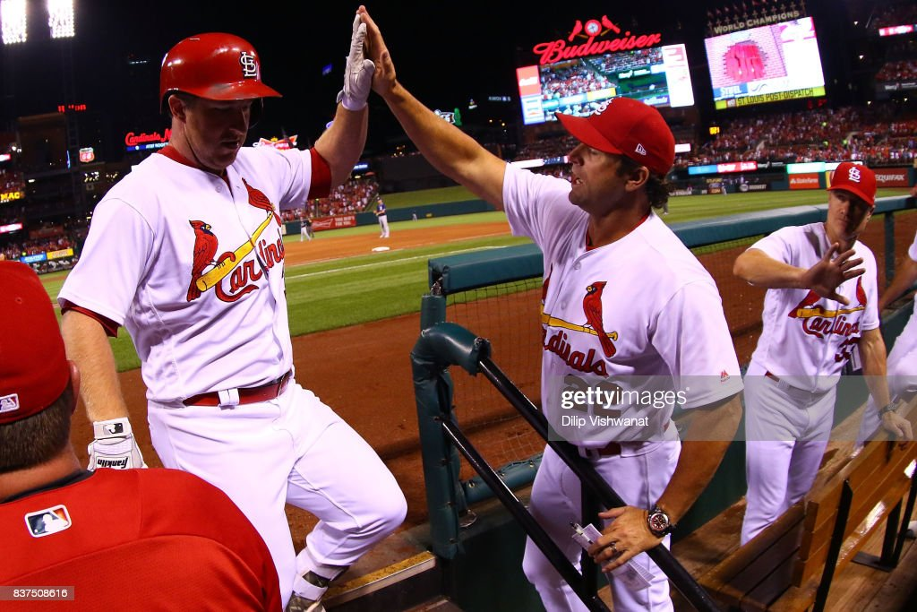 Mike Matheny #22 of the St. Louis Cardinals congratulates Jedd Gyorko #3 of the St. Louis Cardinals after Gyorko hit a two-run home run against the San Diego Padres in the fourth inning at Busch Stadium on August 22, 2017 in St. Louis, Missouri.