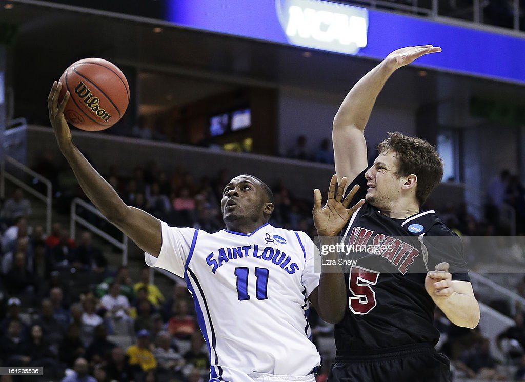 Mike McCall Jr. #11 of the Saint Louis Billikens shoots against Kevin Aronis #5 of the New Mexico State Aggies in the second half during the second round of the 2013 NCAA Men's Basketball Tournament at HP Pavilion on March 21, 2013 in San Jose, California.