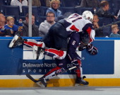 Mike McCarron of Team McClanahan leaps over Cody Corbett of Team Housley at the USA Hockey AllAmerican Prospects Game at the First Niagara Center on...