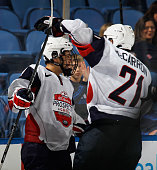 Mike McCarron of Team McClanahan moves in to congratulate Dakota Mermis on his third period goal against Team Housley at the USA Hockey AllAmerican...