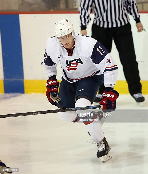 Mike McCarron of USA White skates against Team Sweden during the 2014 USA Hockey Junior Evaluation Camp at the Lake Placid Olympic Center on August 3...