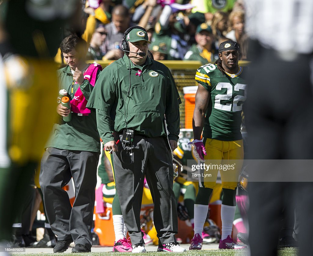Mike McCarthy head coach of the Green Bay Packers stands on the side lines against the Detroit Lions at Lambeau Field on October 6, 2013 in Green Bay, Wisconsin. The Packers defeated the Lions 22-9.