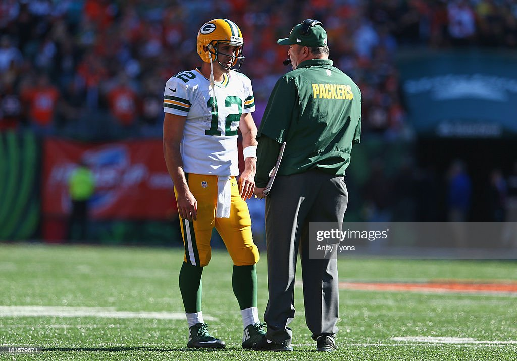 Mike McCarthy the head coach of the Green Bay Packers talks with <a gi-track='captionPersonalityLinkClicked' href=/galleries/search?phrase=Aaron+Rodgers+-+American+Football+Quarterback&family=editorial&specificpeople=215257 ng-click='$event.stopPropagation()'>Aaron Rodgers</a> #12 during the NFL game against Cincinnati Bengals at Paul Brown Stadium on September 22, 2013 in Cincinnati, Ohio.