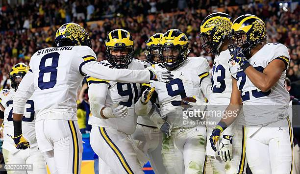 Mike McCray of the Michigan Wolverines celebrates his touchdown after an interception in the third quarter against the Florida State Seminoles during...