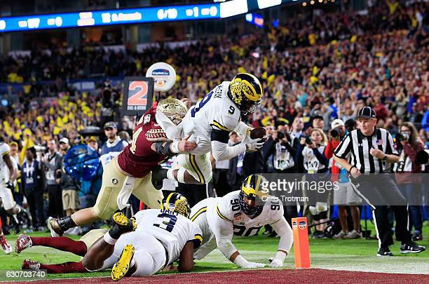 Mike McCray of the Michigan Wolverines scores a touchdown after an interception in the third quarter against the Florida State Seminoles during the...