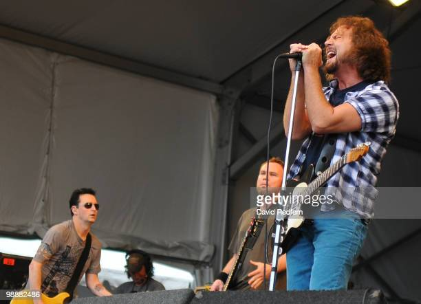 Mike McCready Jeff Ament and Eddie Vedder of Pearl Jam performs on day six of New Orleans Jazz Heritage Festival on May 1 2010 in New Orleans...