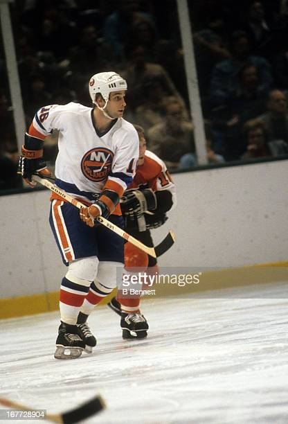 Mike McEwen of the New York Islanders skates on the ice during an NHL game against the Philadelphia Flyers on March 14 1981 at the Nassau Coliseum in...