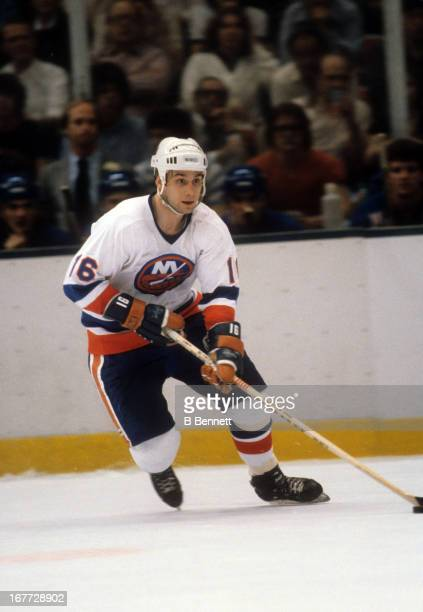 Mike McEwen of the New York Islanders skates with the puck during an 1981 Stanley Cup Semi Finals game against the New York Rangers in April 1981 at...