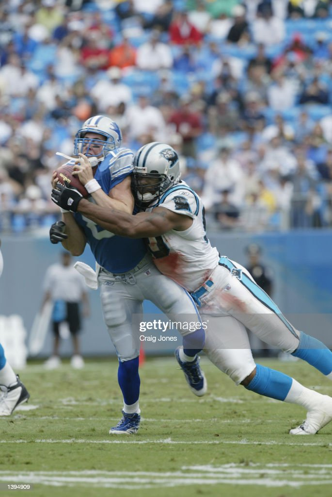 Mike McMahon #8 of the Detroit Lions is sacked by Julius Peppers #90 of the Carolina Panthers on September 15, 2002 at Ericsson Stadium in Charlotte, North Carolina. The Panthers defeated the Lions 31-7.