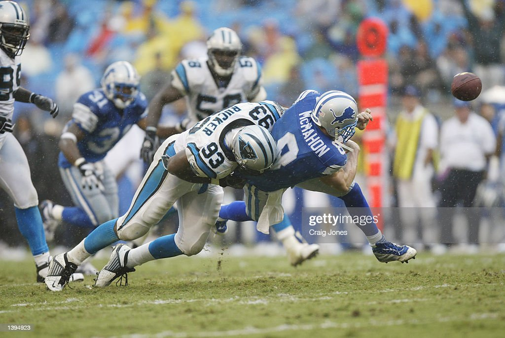 Mike McMahon #8 of the Detroit Lions is sacked by Michael Rucker #93 of the Carolina Panthers on September 15, 2002 at Ericsson Stadium in Charlotte, North Carolina. The Panthers defeated the Lions 31-7.