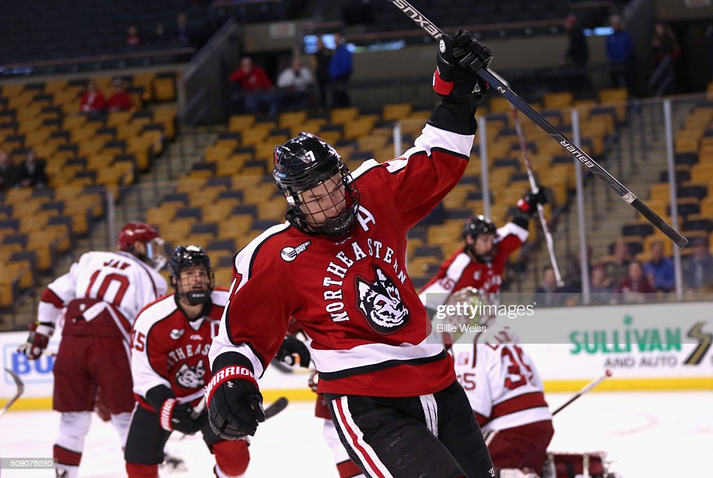 Mike McMurtry #7 of Northeastern University reacts after scoring a goal against Harvard University during the first period of the Beanpot Tournament consolation game at TD Garden on February 8, 2016 in Boston, Massachusetts.