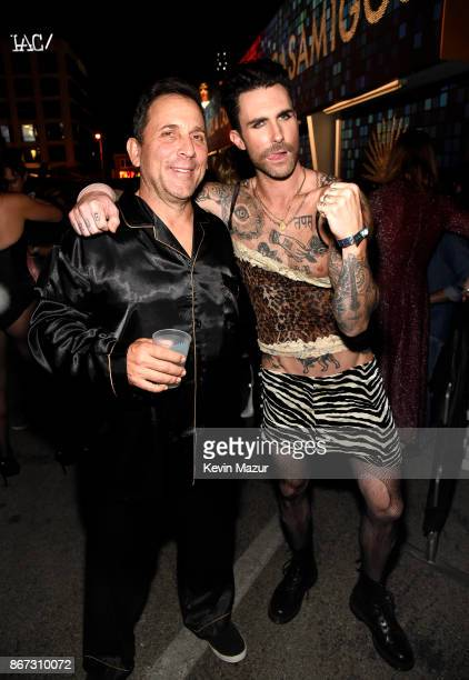 Mike Meldman and Adam Levine of Maroon 5 attend Casamigos Halloween Party on October 27 2017 in Los Angeles California