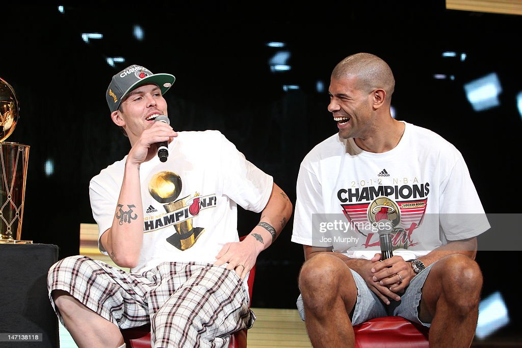Mike Miller #13 and Shane Battier #31 of the Miami Heat smile as they talk to the crowd during a rally for the 2012 NBA Champions Miami Heat on June 25, 2012 at American Airlines Arena in Miami, Florida.