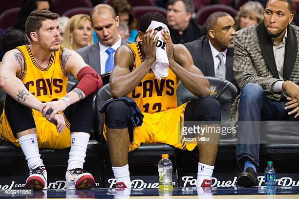 Mike Miller and Tristan Thompson of the Cleveland Cavaliers react on the bench during the second half against the Milwaukee Bucks at Quicken Loans...