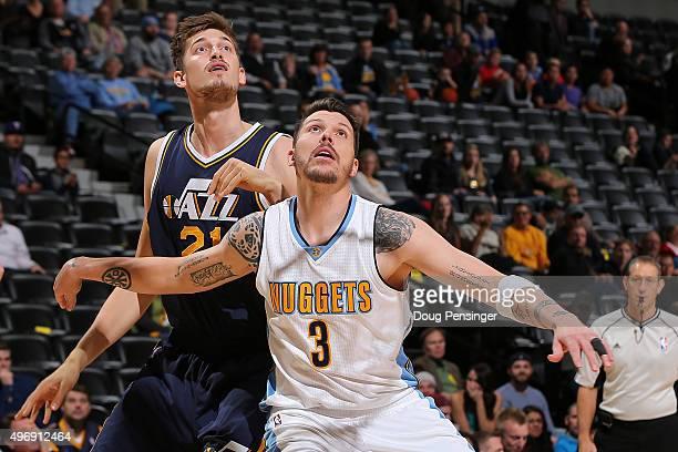 Mike Miller of the Denver Nuggets and Tibor Pleiss of the Utah Jazz battle for rebounding position at Pepsi Center on November 5 2015 in Denver...