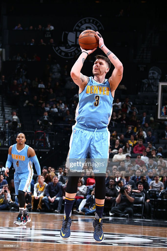 <a gi-track='captionPersonalityLinkClicked' href=/galleries/search?phrase=Mike+Miller+-+Basketball+Player&family=editorial&specificpeople=201801 ng-click='$event.stopPropagation()'>Mike Miller</a> #3 of the Denver Nuggets shoots against the Brooklyn Nets during the game on February 8, 2016 at Barclays Center in Brooklyn, New York.