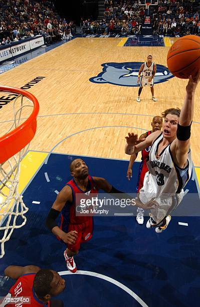 Mike Miller of the Memphis Grizzlies shoots over Cuttino Mobley of the Los Angeles Clippers on December 9 2006 at FedExForum in Memphis Tennessee The...