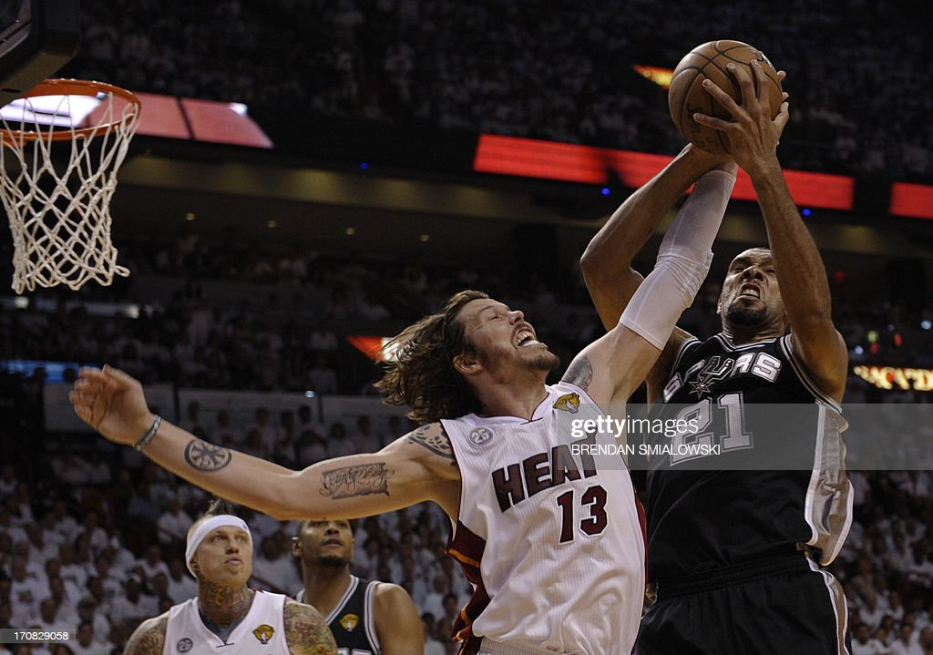 Mike Miller (L) of the Miami Heat and Tim Duncan (R) of the San Antonio Spurs fight for a rebound during the first half in Game 6 of the NBA Finals at the American Airlines Arena June 19, 2013 in Miami, Florida. AFP PHOTO / Brendan SMIALOWSKI