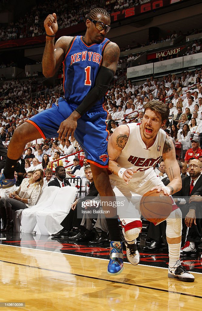 Mike Miller #13 of the Miami Heat dribbles the ball around a leaping Amare Stoudemire #1 of the New York Knicks in Game Two of the Eastern Conference Quarterfinals during the 2012 NBA Playoffs on April 30, 2012 at American Airlines Arena in Miami, Florida.
