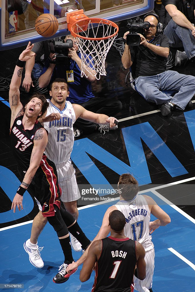 Mike Miller #13 of the Miami Heat drives to the basket against Hedo Turkoglu #15 of the Orlando Magic on December 31, 2012 at Amway Center in Orlando, Florida.