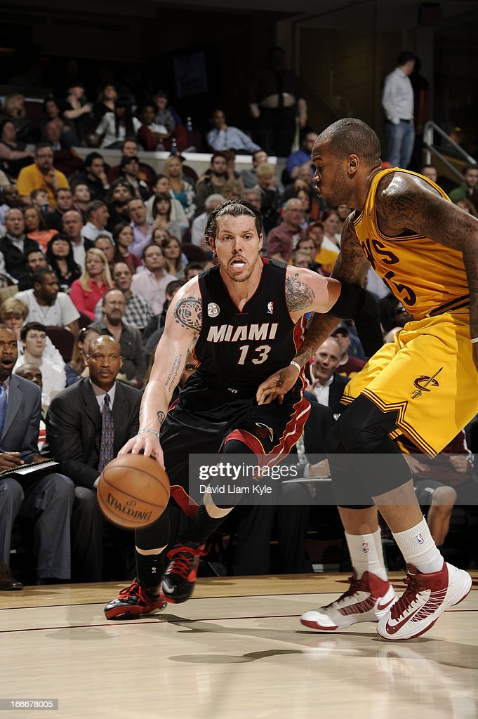 Mike Miller #13 of the Miami Heat drives to the hoop against Marreese Speights #15 of the Cleveland Cavaliers at The Quicken Loans Arena on April 15, 2013 in Cleveland, Ohio.