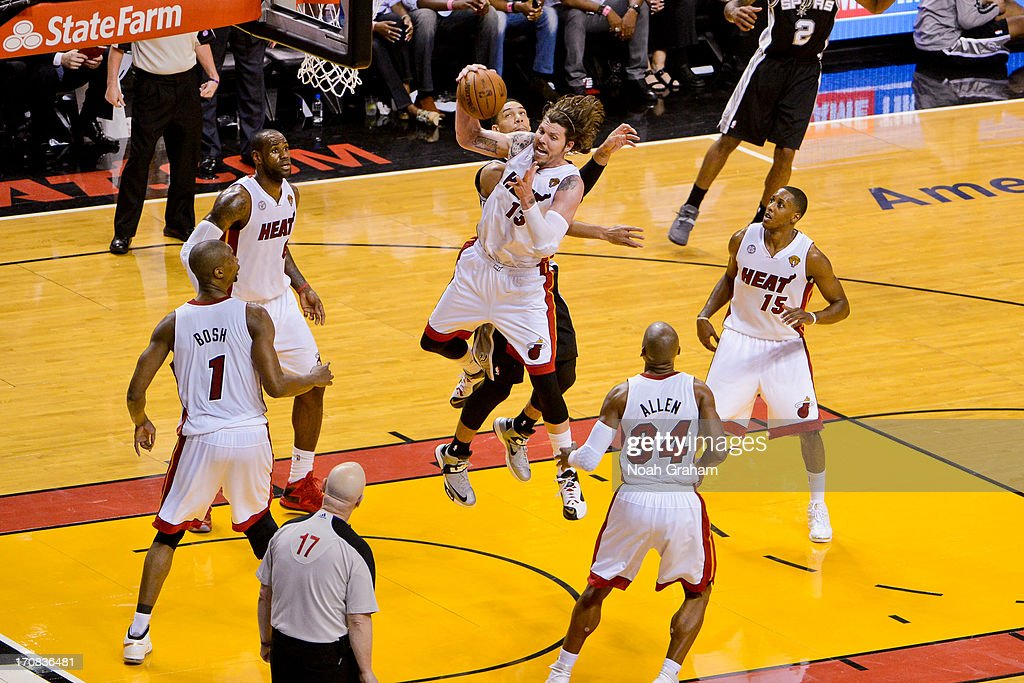 Mike Miller #13 of the Miami Heat grabs a rebound against the San Antonio Spurs during Game Six of the 2013 NBA Finals on June 18, 2013 at American Airlines Arena in Miami, Florida.