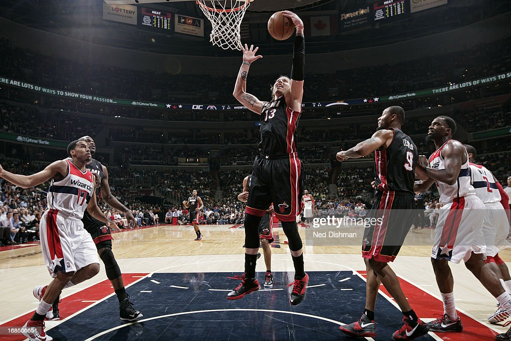 <a gi-track='captionPersonalityLinkClicked' href=/galleries/search?phrase=Mike+Miller+-+Basketball+Player&family=editorial&specificpeople=201801 ng-click='$event.stopPropagation()'>Mike Miller</a> #13 of the Miami Heat grabs a rebound against the Washington Wizards at the Verizon Center on April 10, 2013 in Washington, DC.