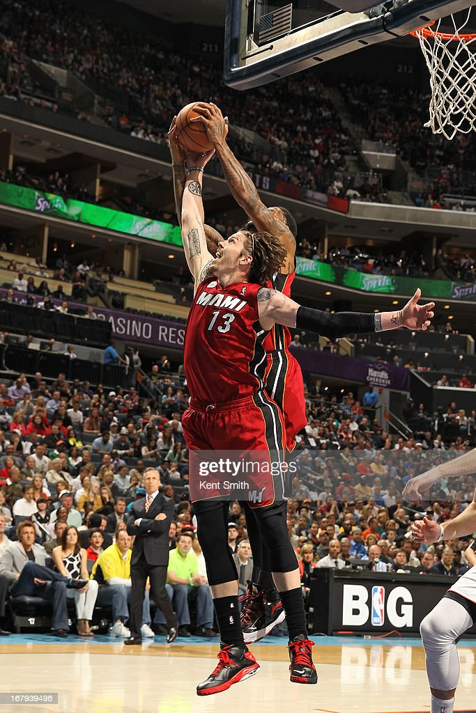 <a gi-track='captionPersonalityLinkClicked' href=/galleries/search?phrase=Mike+Miller+-+Basketballer&family=editorial&specificpeople=201801 ng-click='$event.stopPropagation()'>Mike Miller</a> #13 of the Miami Heat grabs the rebound against the Charlotte Bobcats at the Time Warner Cable Arena on April 5, 2013 in Charlotte, North Carolina.