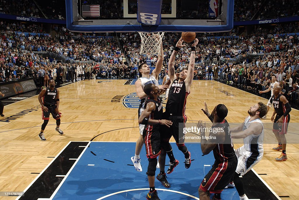 <a gi-track='captionPersonalityLinkClicked' href=/galleries/search?phrase=Mike+Miller+-+Basketballer&family=editorial&specificpeople=201801 ng-click='$event.stopPropagation()'>Mike Miller</a> #13 of the Miami Heat grabs the rebound against the Orlando Magic on December 31, 2012 at Amway Center in Orlando, Florida.