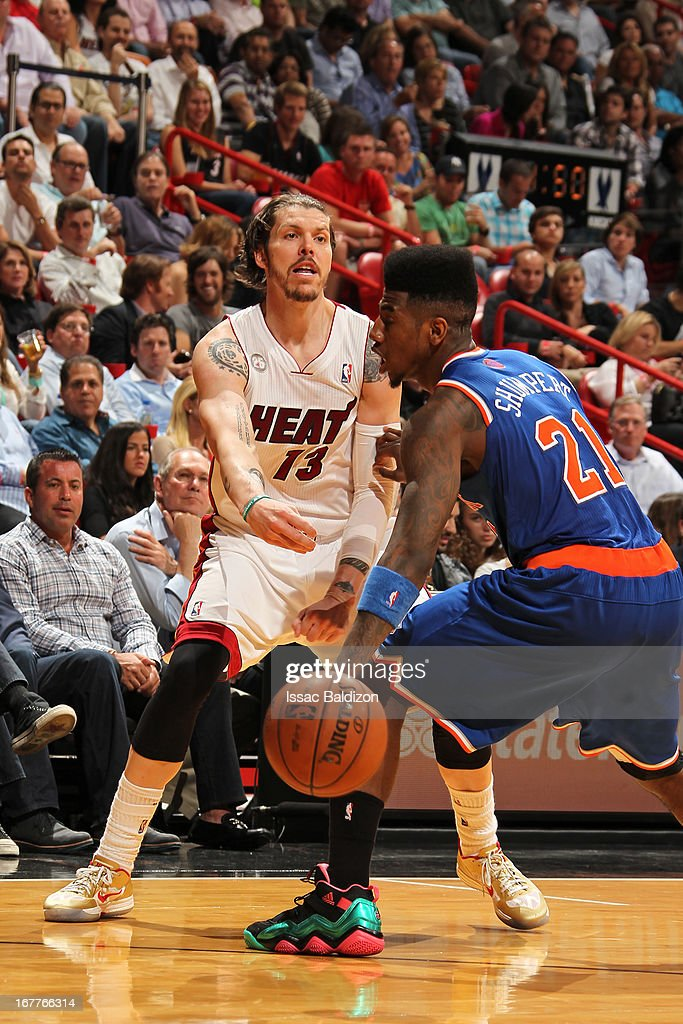 Mike Miller #13 of the Miami Heat passes the ball against Iman Shumpert #21 of the New York Knicks on April 2, 2013 at American Airlines Arena in Miami, Florida.