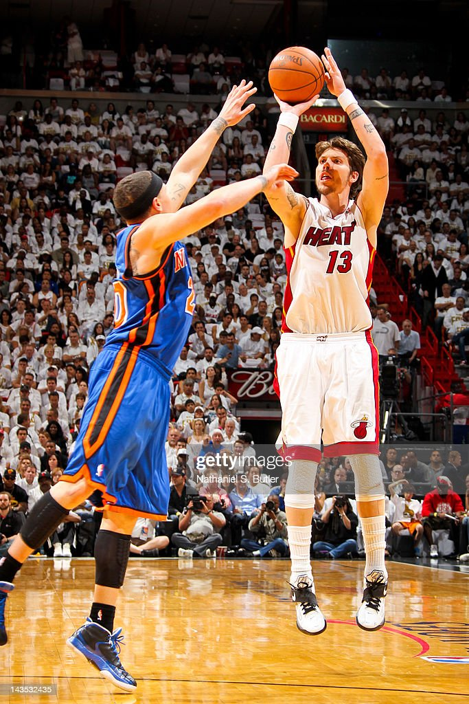 Mike Miller #13 of the Miami Heat shoots against Mike Bibby #20 of the New York Knicks in Game One of the Eastern Conference Quarterfinals during the 2012 NBA Playoffs on April 28, 2012 at American Airlines Arena in Miami, Florida.
