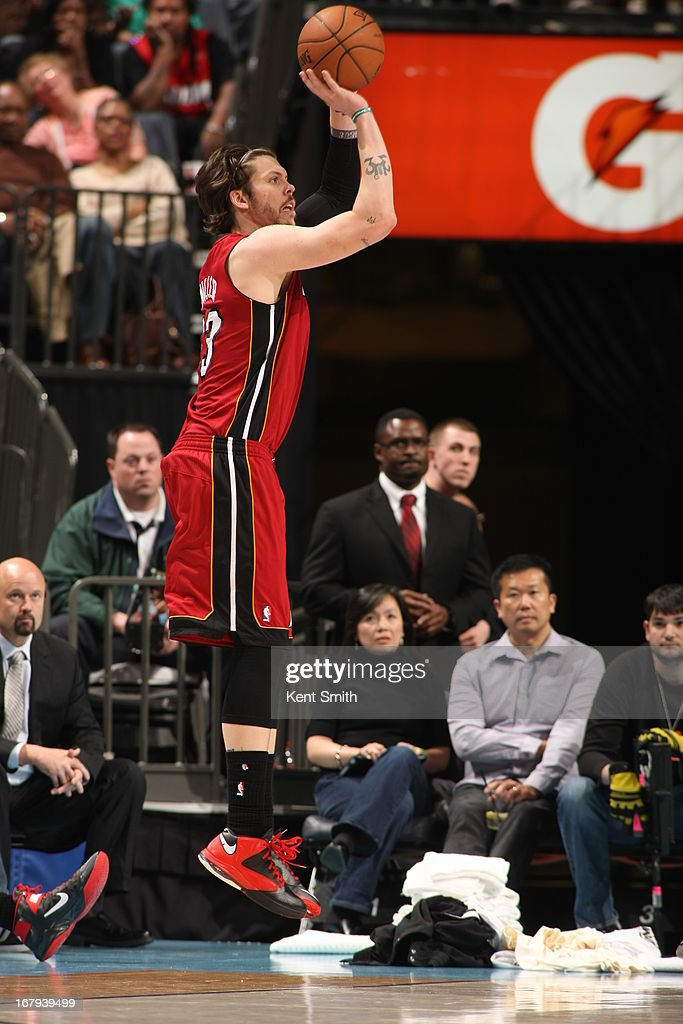 <a gi-track='captionPersonalityLinkClicked' href=/galleries/search?phrase=Mike+Miller+-+Basketballer&family=editorial&specificpeople=201801 ng-click='$event.stopPropagation()'>Mike Miller</a> #13 of the Miami Heat shoots the ball against the Charlotte Bobcats at the Time Warner Cable Arena on April 5, 2013 in Charlotte, North Carolina.