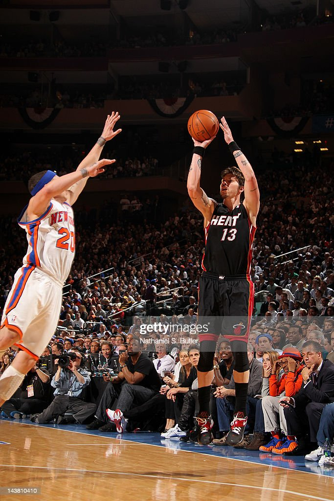 Mike Miller #13 of the Miami Heat takes a jump shot against Mike Bibby #20 of the New York Knicks in Game Three of the Eastern Conference Quarterfinals during the 2012 NBA Playoffs on May 3, 2012 at Madison Square Garden in New York City.