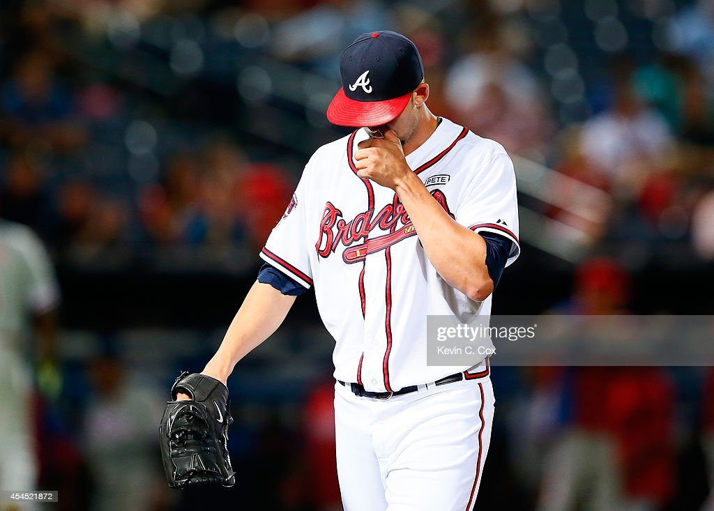<a gi-track='captionPersonalityLinkClicked' href=/galleries/search?phrase=Mike+Minor+-+Baseball+Player&family=editorial&specificpeople=6795776 ng-click='$event.stopPropagation()'>Mike Minor</a> #36 of the Atlanta Braves is relieved in the eighth inning against the Philadelphia Phillies at Turner Field on September 2, 2014 in Atlanta, Georgia.