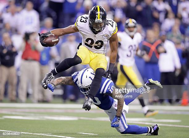 Mike Mitchell of the Pittsburgh Steelers hurdles Donte Moncrief of the Indianapolis Colts as he returns an interception during the fourth quarter of...