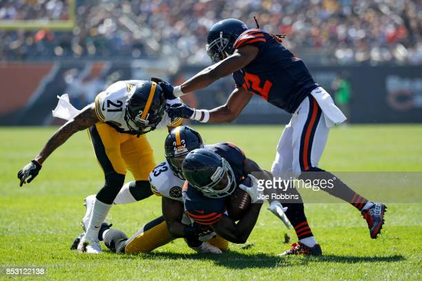 Mike Mitchell of the Pittsburgh Steelers tackles Tarik Cohen of the Chicago Bears in the first quarter at Soldier Field on September 24 2017 in...