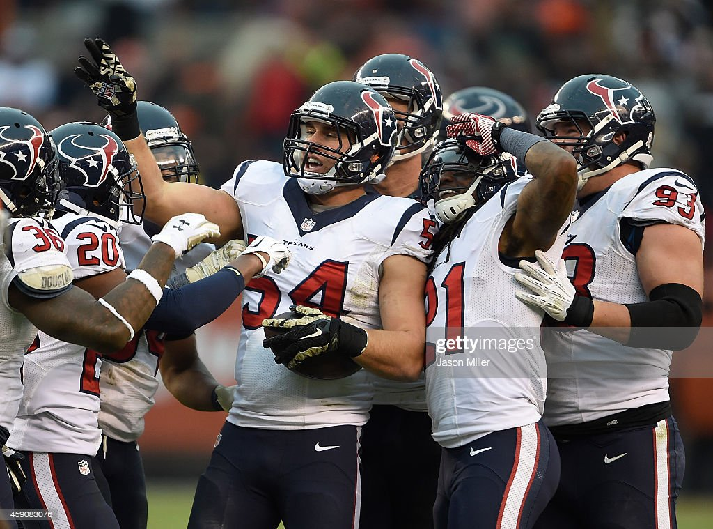 Mike Mohamed #54 of the Houston Texans celebrates his interception with teammates during the fourth quarter against the Cleveland Browns at FirstEnergy Stadium on November 16, 2014 in Cleveland, Ohio.