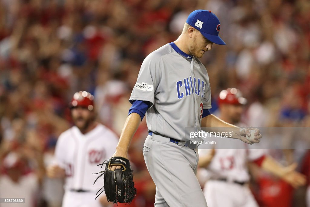 Mike Montgomery #38 of the Chicago Cubs reacts to a three run Bryce Harper #34 of the Washington Nationals home run against the Chicago Cubs in the eighth inning during game two of the National League Division Series at Nationals Park on October 7, 2017 in Washington, DC.