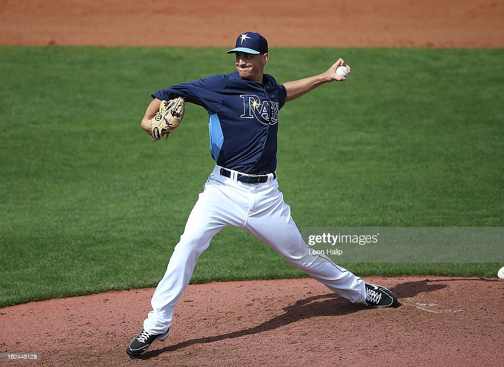 <a gi-track='captionPersonalityLinkClicked' href=/galleries/search?phrase=Mike+Montgomery&family=editorial&specificpeople=206875 ng-click='$event.stopPropagation()'>Mike Montgomery</a> #31 of the Tampa Bay Rays pitches during the Spring Training game against Pittsburgh Pirates on February 23, 2013 in Port Charlotte, Florida. The Pirates defeated the Rays 3-2.