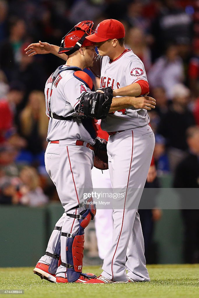 Mike Morin #64 of the Los Angeles Angels of Anaheim celebrates with Chris Iannetta #17 after their 12-5 win over the Boston Red Sox at Fenway Park on May 22, 2015 in Boston, Massachusetts.