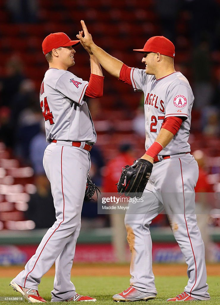 Mike Morin #64 of the Los Angeles Angels of Anaheim celebrates with Mike Trout #27 after their 12-5 win over the Boston Red Sox at Fenway Park on May 22, 2015 in Boston, Massachusetts.