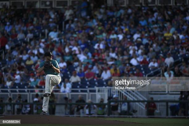 Mike Morrison of Coastal Carolina University delivers a pitch against University of Arizona during the Division I Men's Baseball Championship held at...