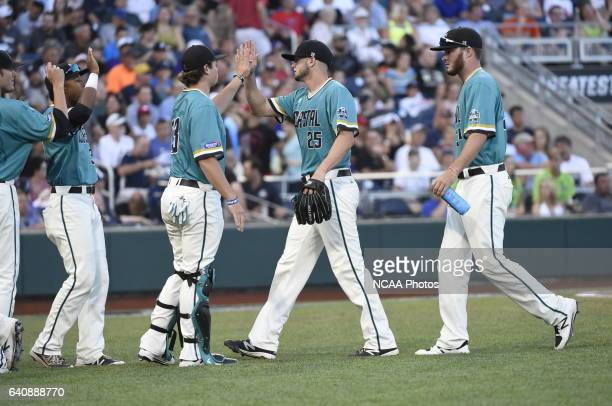 Mike Morrison of Coastal Carolina University receives highfives from teammates after recording the last out of the inning against University of...