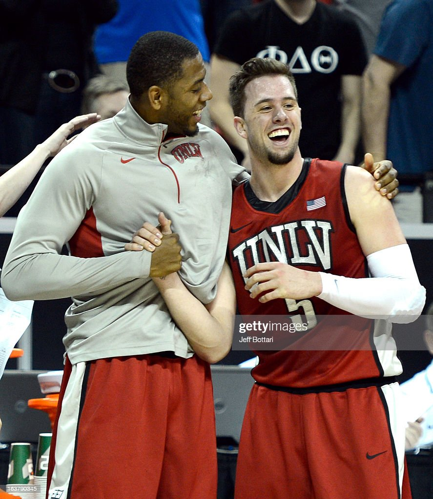 Mike Moser #43 and Katin Reinhardt #5 of the UNLV Rebels share a laugh during the second half of a semifinal game of the Reese's Mountain West Conference Basketball tournament against the Colorado State Rams at the Thomas & Mack Center on March 15, 2013 in Las Vegas, Nevada. UNLV won 75-65.