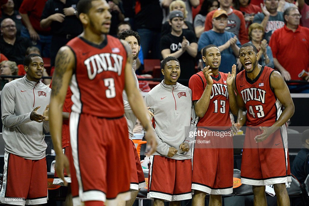 Mike Moser #43, Bryce DeJean-Jones #13 and Daquan Cook #10 of the UNLV Rebels react on the bench during the first half of a semifinal game of the Reese's Mountain West Conference Basketball tournament against the Colorado State Rams at the Thomas & Mack Center on March 15, 2013 in Las Vegas, Nevada.