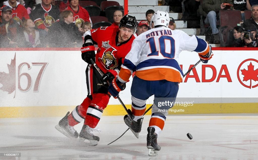 <a gi-track='captionPersonalityLinkClicked' href=/galleries/search?phrase=Mike+Mottau&family=editorial&specificpeople=848917 ng-click='$event.stopPropagation()'>Mike Mottau</a> #10 of the New York Islanders blocks a shot by Kaspars Daugavins #23 of the Ottawa Senators at Scotiabank Place on February 26, 2012 in Ottawa, Ontario, Canada.
